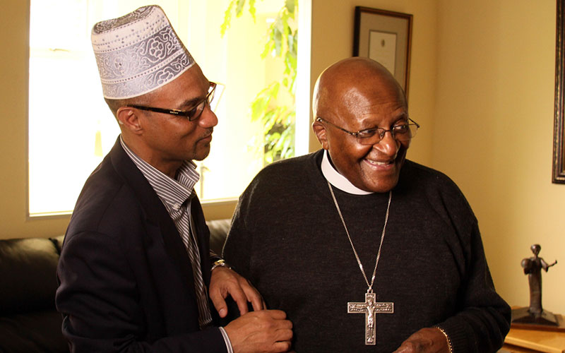 Kroc Institute for International Studies professor Rashied Omar in South Africa with Archbishop Desmond Tutu