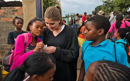 Laura Straccia talks with students at the Kliptown Youth Project near Johannesburg, South Africa